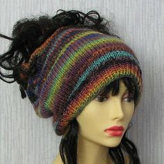 This hand knit baggy hat was crafted using a rich variegated wool/acrylic blend yarn. With a circumference of roughly 24 inches (that will stretch