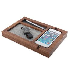 Tinsel & Timber's beautifully handcrafted Walnut Timber Tray for iPhone 6 ($79) perfectly fits his device, watch, keys, cuff links, and other daily essentials. It's an automatic desk organizer! Merino wool felt will protect items from scratching, and cork feet on the bottom keep the tray in place. Bonus point: the product is made in the USA. There's an iPhone 5/5S version ($59) too.