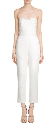 A high-style alternative to sundresses, Tamara Mellon's crisp white jumpsuit is both understated and edgy. Rendered with a touch of stretch to keep the perfect fit, this strapless one-piece dresses both up and down effortlessly #Stylebop