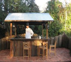 simple corrogated roof and cedar sides outdoor bar