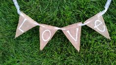 White and Lace burlap love banner  photo by whatsyoursigndesigns, $12.00