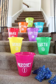 Off with this Out of This World Birthday Party Game: a fun planet toss on the stairs with bean bags and buckets.Game: a fun planet toss on the stairs with bean bags and buckets. Outer Space Theme, Outer Space Party, Astronaut Party, Alien Party, Science Party, Birthday Parties, 5th Birthday, Birthday Party Games Indoor, Birthday Blast