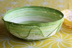 Yarn bowls - Such a cute kid's craft! Could probably do it with magazine/newspaper or tissue paper too?