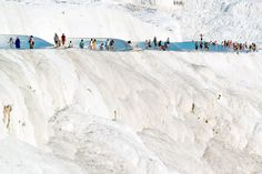 "Pamukkale, meaning ""cotton castle"" in Turkish, is a natural site in Denizli Province in southwestern Turkey. The area is famous for its hot springs and enormous white terraces of travertine, a carbonate mineral left by the flowing water. It is located in Turkey's Inner Aegean region, in the River Menderes valley, which has a temperate climate for most of the year. The ancient Greco-Roman city of Hierapolis was built on top of the white ""castle"" which is in total about ..."