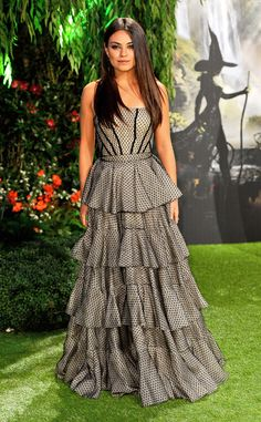Mila Kunis looks fabulously frilly in a strapless Alexander McQueen gown.