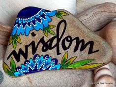 wisdom. intuition. inner knowing. knowledge. word for the year. painted rock (sea stone) from Cape Cod. This stone is very smooth and flat and