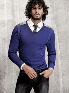 Blue w/ touches of grey Sweater, collared shirt, tie, jeans