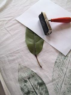 Any kind of leaf + inexpensive shower curtain liner to create your own designer original.   Use nontoxic Dharma Pigment Dye-gives soft stonewashed look.  Paint veined side of the leaf with dye or paint. Don't forget the stem.  Press into fabric cover with paper. Smooth by hand.    Photo by Susan Wasinger