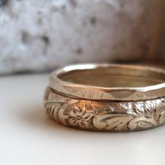One 5mm renaissance pattern and one 1.5mm hammered plain ring make this sleek, feminine, but earthy set of 14k gold fill stacking rings.
