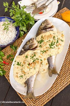 Photo about Spicy fish served on white platter with tahini sauce. Image of wood, bream, rice - 59846130 Tahini Sauce, Lebanese Recipes, Happy Foods, Yummy Food, Delicious Recipes, Camembert Cheese, Seafood, Spicy, Fish