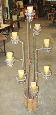 old insulators made into candle holders. JW: perhaps you could make something similar out of piping.