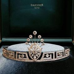 A more modern diamond tiara from Iskender, but using old motifs with the Greek Key or Meander motifs, topped with a diamond floral spray at the center.