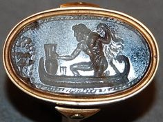 Onyx scarab intaglio: Charon in a boat on the Styx, confronting Cerberus.