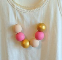 #modernjewelry hand painted gold, pink, + nude necklace