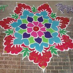 Rangoli is a sure shot way to add colour to your home. Here are some simple rangoli designs you can try!