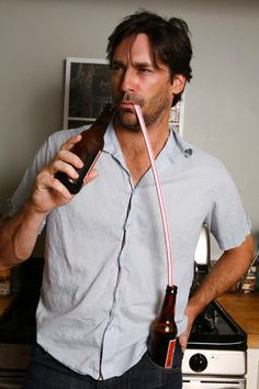 Jon Hamm: looks like those are Budweiser bottles, of course...he's from St. Louis