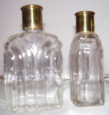 Two Merle Norman cosmetic bottles from the 1940's