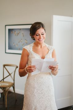 Reading letter from groom on wedding day. Wedding at The Cordelle in Nashville, Tennessee.