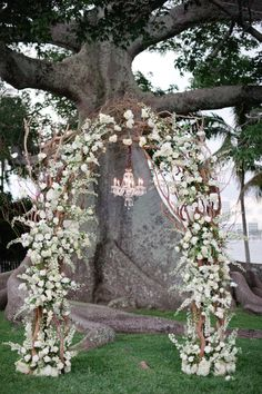 a floraled arch perfect for marrying under  Photography by katielopezphotography.com, Planning by celebrationsbydesignevents.com, Floral Design by xquisiteeventsfl.com