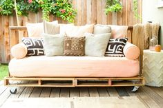 Outdoor porch couch-paint double pallets, use day bed mattress, extra pillows; citrus colors