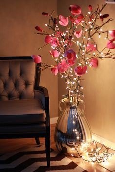 In lieu of a tree, loosely strung a few lights around existing decorative vase with flowers.