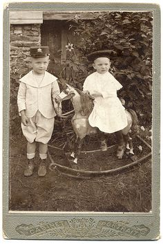 Two boys with a rocking horse