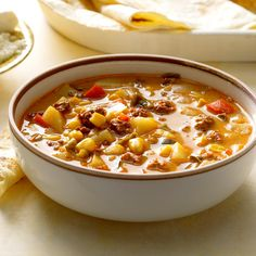 Mexican Chorizo and Corn Soup Recipe -This filling soup is great when you need to warm up on a blustery day! If you want a chowder consistency, use a potato masher to break down some of the spuds. Chorizo Soup Recipes, Corn Soup Recipes, Mexican Food Recipes, Entree Recipes, Pork Recipes, Chicken Recipes, Dinner Recipes, Cooking Recipes, Ethnic Recipes