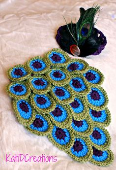 Peacock Inspired Photo Prop by Kati D Creations  12 Adorable Baby #Crochet Patterns compiled by CrochetStreet.com