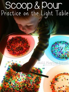 Scoop and Pour: Practical Life Serving Practice on the Light Table from Still Playing School Reggio Emilia, Overhead Projector, Sensory Table, Sensory Play, Sand And Water Table, Clever Kids, Fire Pit Lighting, Light Panel, Water Beads