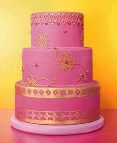 Nice henna design. chains insteadof repeated everywhere. Pink and gold Indian wedding cake
