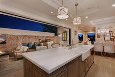 Large kitchen island. This kitchen is perfect for cooking and entertaining. #kitchenisland #kitchen Patterson Custom Homes. Interiors by Trish Steele, Churchill Design.