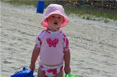 always protect your little ones from the strong sun... sunscreen, hats, and glasses are a must
