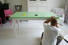 staple an oil cloth to an old dining table for a kids craft table. Love this idea!!