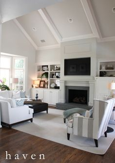 Great example of what I want to do in the living room as far as the fireplace, tv and built-ins go.