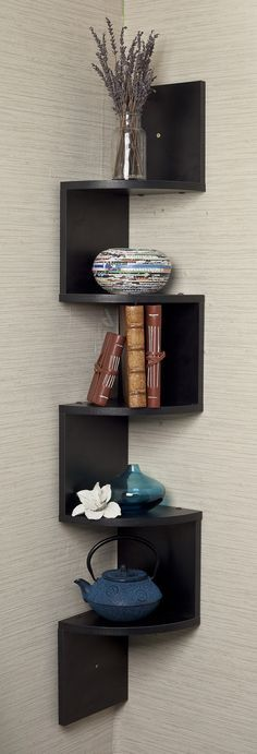 This zig zag corner wall shelf is a stylish and unique way to hold your belongings.