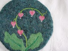 Wool Felted Coasters with a Needle Felted Bleeding Heart Design Felted Soap, Felt Coasters, Felted Wool Crafts, Wool Quilts, Needle Felting Tutorials, Wool Art, Felt Decorations, Heart Crafts, Penny Rugs