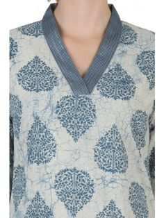 Kashish Kurta with blue big buta print. Highlighted with couched shantung silk trim with silver thread and sequins work. Color Grey, Off-White, Indigo Size Refer to size chart. Model is wearing size XS. Salwar Neck Patterns, Neck Patterns For Kurtis, Salwar Suit Neck Designs, Silk Kurti Designs, Kurta Neck Design, Salwar Designs, Kurta Designs Women, Kurtha Designs, Chudi Neck Designs