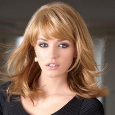 contemporary, longer bangs blend into the layered sides to frame your face beautifully. #paulayoung #wig #hair