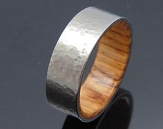 Hammered Titanium Ring With A Mahogany Wooden by jewelrybyjohan