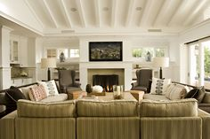 Salisbury Ticking in Espresso covers the two arm chairs in this living room by designers at Bonesteel Trout Hall
