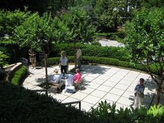 oval patio of cut concrete - photographed by Heather Moll-Dunn Landscape and Garden Design on the Gardens for Connoisseurs Tour in Atlanta