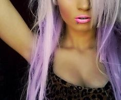 purple and blonde hair, pink lips.
