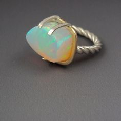I love this unusually thick-cut opal from stoneaddict.etsy.com