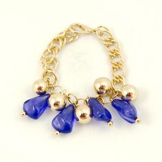 Blue Cluster Charm Bracelet:This charming charm bracelet is a vintage item. The gold chain bracelet measure 7 inches with a clasp closure and features little round gold beads and pretty blue glass beads. Brand new dead stock and has never been worn. $16.00