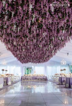 I would probably drop my whole wedding budget on this ceiling garden. (Purpled Wedding Decor - this wisteria ceiling is amazing.)