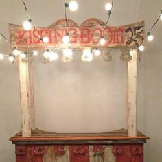 kissing booth at the reception! I think this would be sooooo cute instead of a photo booth! Hang pics of us from it, I'm loving this idea!