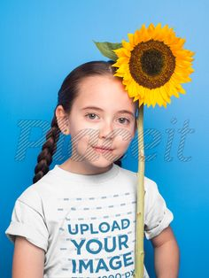 ea28c82b58 Pretty Little Girl with Braids Wearing a Tshirt Mockup Holding a Sunflower  a19733