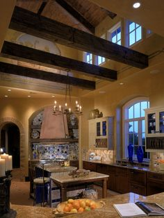 Love the rustic feel. Cool beams with higher ceiling in kitchen above beams. Great for extra heat from kitchen.