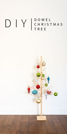 This cute DIY Wooden Dowel Christmas Tree is the perfect addition to your minimalist, modern (CUTE!) Christmas decor! | Vintage Revivals #diychristmasdecor #christmas #diyhomedecor
