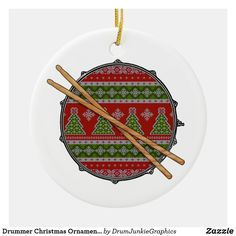 "This cool drummer ornament features a snare drum with and ""ugly Christmas sweater"" design, and a pair of crossed drum sticks. Perfect gift idea for musicians, music fans and drum enthusiasts! Check out www.drumjunkiegraphics.com for more great drummer merch and musician gifts - all designed by a drummer! #drummerchristmas #musicianchristmas #snaredrum #marchingband #drumline #drumjunkie"